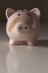 2221736-piggy-bank-with-bandage-on-face